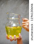 hands holding a jar of rice... | Shutterstock . vector #1196130646