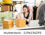 young asian women packing cloth ...   Shutterstock . vector #1196156293