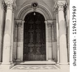 A Large Wooden Door With Gothic ...