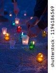a man lights a candle standing... | Shutterstock . vector #1196186569