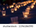 a group of candles burning in... | Shutterstock . vector #1196186590