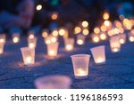 a group of candles burning in... | Shutterstock . vector #1196186593