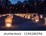 a group of candles burning in... | Shutterstock . vector #1196186596