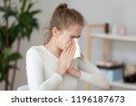 young millennial sick woman... | Shutterstock . vector #1196187673