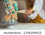 Woman Pastry Chef Decorating A...