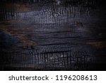 burnt wooden board texture.... | Shutterstock . vector #1196208613