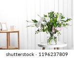 glass vase with bouquet of... | Shutterstock . vector #1196237809