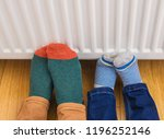 woman and child warming cold... | Shutterstock . vector #1196252146