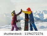 couple snowboarding freeriders... | Shutterstock . vector #1196272276