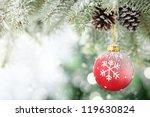 Red Christmas Ball Hanging On...