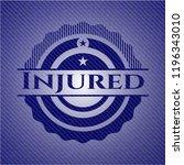 injured badge with denim texture | Shutterstock .eps vector #1196343010