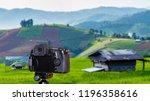 digital camera over tripod on... | Shutterstock . vector #1196358616