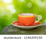 closeup of a cup of coffee on... | Shutterstock . vector #1196359150