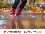 child in rubber boots standing... | Shutterstock . vector #1196379706
