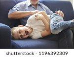 grandpa and grandson having a... | Shutterstock . vector #1196392309