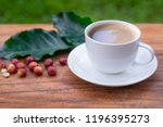 coffee cup on wooden table with ... | Shutterstock . vector #1196395273