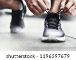 close up of sportsman tying... | Shutterstock . vector #1196397679