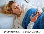 girl face watching her mobile... | Shutterstock . vector #1196428450