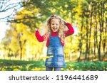 pretty little girl have fun in... | Shutterstock . vector #1196441689