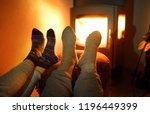 couple wearing woollen socks...   Shutterstock . vector #1196449399