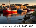 Fishing Boats At Sunset In...