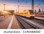 orange high speed train on the... | Shutterstock . vector #1196488000