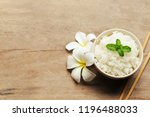 cooked rice in a bowl on wooden ... | Shutterstock . vector #1196488033