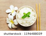 cooked rice in a bowl on wooden ... | Shutterstock . vector #1196488039