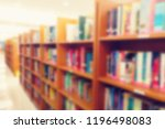 blurred image of bookshelf in... | Shutterstock . vector #1196498083