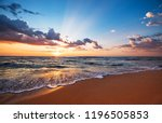 colorful ocean beach sunrise. | Shutterstock . vector #1196505853