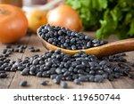black beans in a wooden spoon... | Shutterstock . vector #119650744