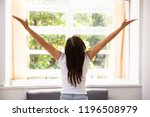 woman stretching her arms in... | Shutterstock . vector #1196508979