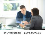 two young businesspeople using... | Shutterstock . vector #1196509189