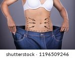 woman with correction lines on... | Shutterstock . vector #1196509246
