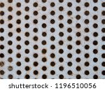 Rusted Metal Surface With Holes....