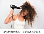pretty young woman blowing her... | Shutterstock . vector #1196543416