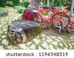 Red Vintage Bicycle In The Par...