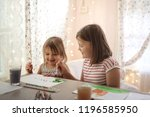 children girls together paint... | Shutterstock . vector #1196585950