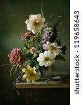 Small photo of Beautiful still life with a voluptuous bouquet of flowers