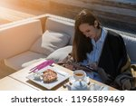 young woman sitting on the... | Shutterstock . vector #1196589469