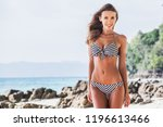 woman in bikini walking on... | Shutterstock . vector #1196613466