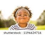 happy african american little... | Shutterstock . vector #1196624716