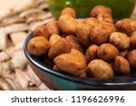 peanuts coated full in the bowl ... | Shutterstock . vector #1196626996