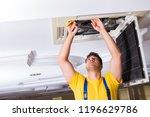 repairman repairing ceiling air ... | Shutterstock . vector #1196629786