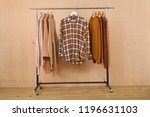 row of women sweater  stripy... | Shutterstock . vector #1196631103