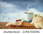 coffee cup on a rainy day over... | Shutterstock . vector #1196703346