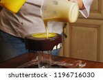 cook is preparing mousse cake... | Shutterstock . vector #1196716030