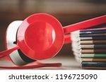 headphones besides pile of books | Shutterstock . vector #1196725090
