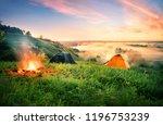 orange tent and bonfire over... | Shutterstock . vector #1196753239