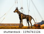 xolo the giant dog being lifted ... | Shutterstock . vector #1196761126